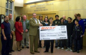 BNSF Railway Company Matt Garland presents a check for $50,000 to ITEP's Carol Rowen to fund education programs at Banning High for next three years. The donation ceremony was held Friday, Dec. 12,, 2008 at a BNSF Railway Company terminal in Barstow. (Photo by Dave Park)