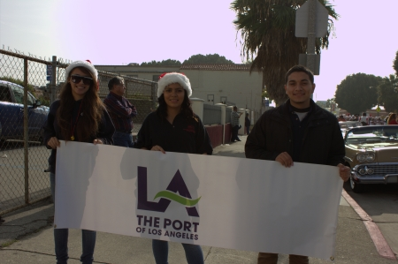 ITEP students ready to march with a Port of LA banner.