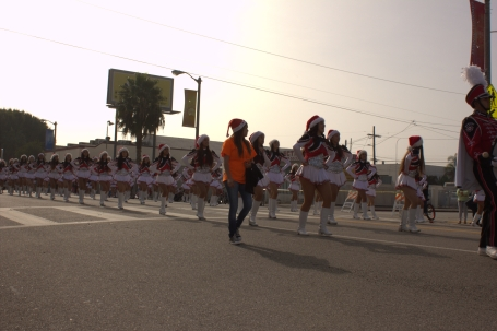A GSS student walks along the Banning High School drill team.