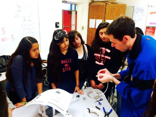 Mike Haworth, an engineer from Phillips 66, helped students improve their robot assembly by providing tips on waterproofing and soldering for underwater operation.