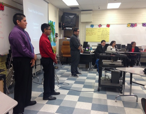 Incoming ITEP freshmen presenting to a room full of students, teachers, parents, and local business panelists.